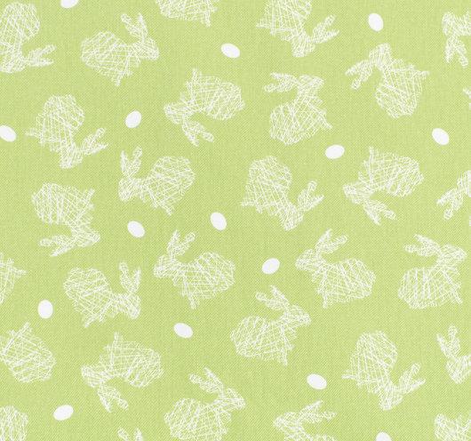 Zelena tkanina sa uskršnjim zečevima i jajima.