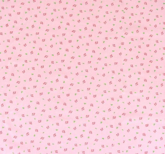 Ružičasta tkanina s motivom cvjetića.