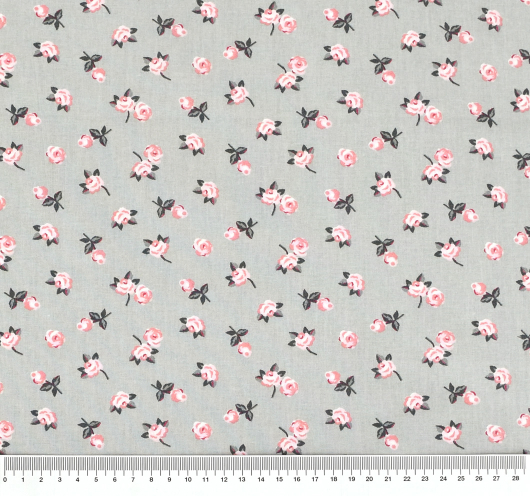 Siva tkanina s dezenom ružičastih cvjetova.