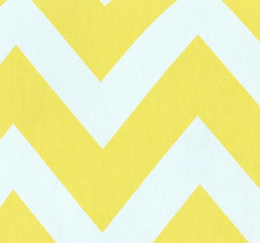 Ukrasni jastuk s kombiniranim žuto-bijelim cik-cak dezenom.