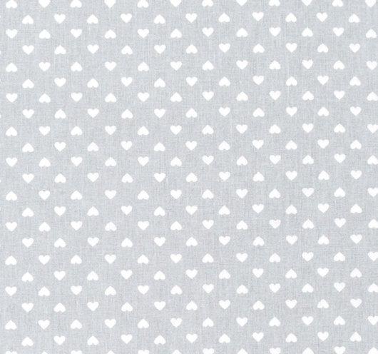 Siva tkanina s bijelim srcima.