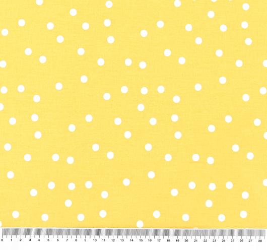 Žuta tkanina na točkice.