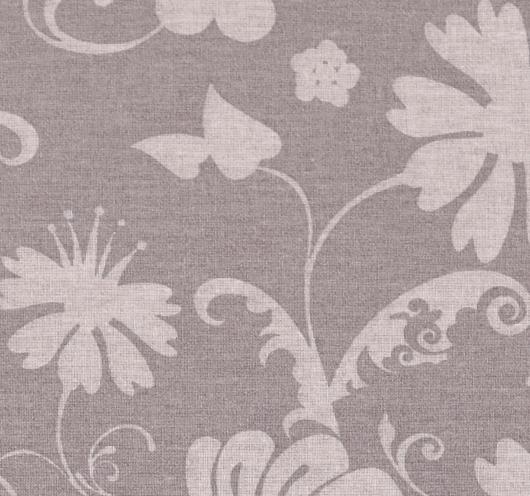 Smeđa tkanina sa stiliziranim cvjetovima.